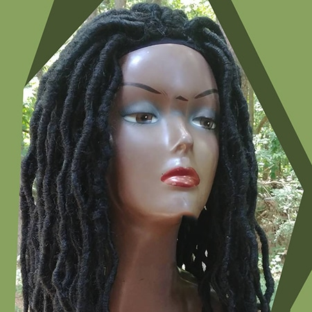 Wonderful and wild bohemian black dreadlocks wig in the forest of africa.